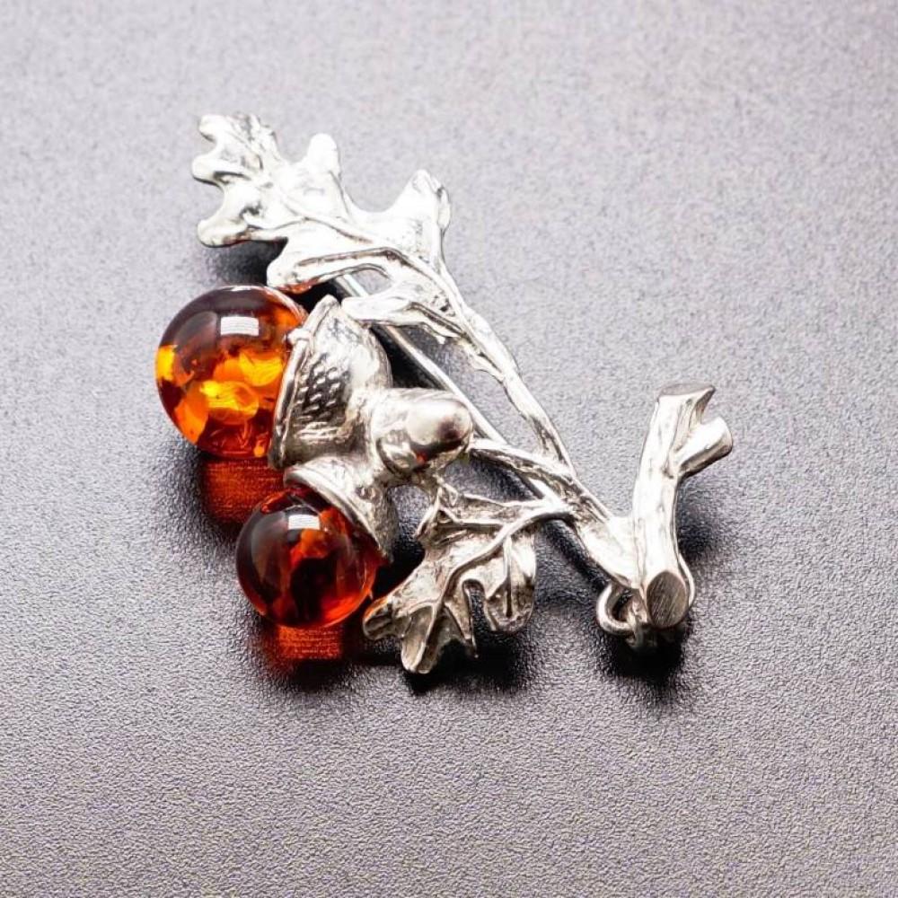Брошь Желуди янтарь коричневый посеребрение 250